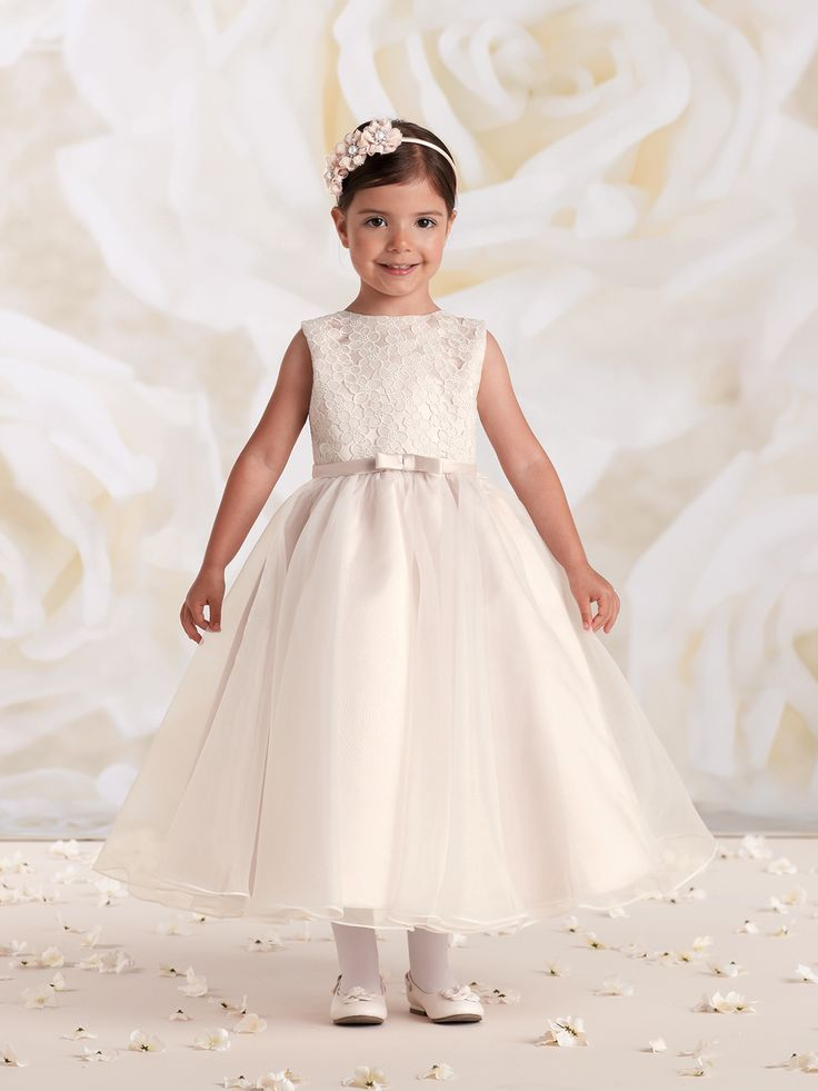 Sleeveless satin, organza and lace tea-length A-line dress, satin bodice features a cutout embroidered lace overlay, thin satin waistband with center front bow, covered buttons down back, full gathered organza overlay circle skirt, ideal as a First Communion dress. NEW for Spring 2015: Ivory/Petal.Sizes: 2 - 14
