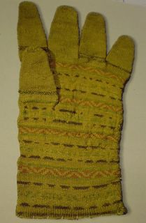 This glove is from Upsala, Sweden in the sixteenth century and by tradition it was worn by Captain Sten Svantesson Sture when he died in a battle 1565, against the Danish. The words Frevchen Sofia are worked in knitting across the palm.  The Stures kept this glove for many years in a vault along with other garments of  family significance .