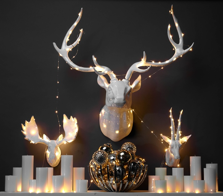 Deck the walls with holiday cheer by creatively stringing lights across fauxidermy or wall decor.