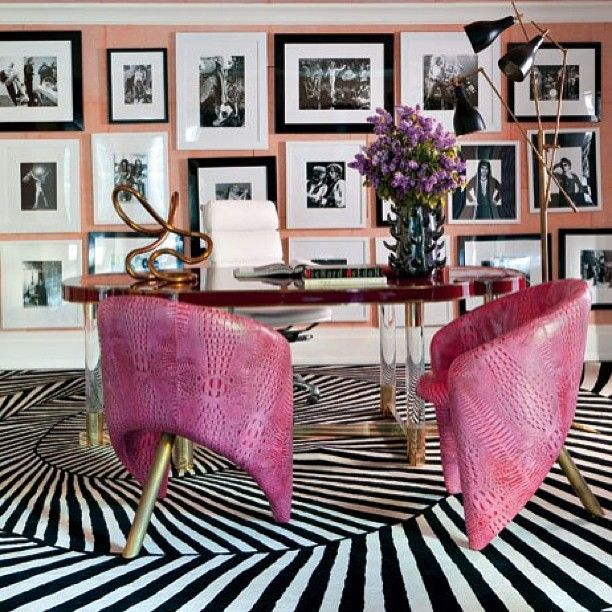 black and white office decor. Raspberry leather chairs by designer Kelly Wearstler bring color to a Bel  Air California office where collection of photos is displayed 219 best Black White Office images on Pinterest At home