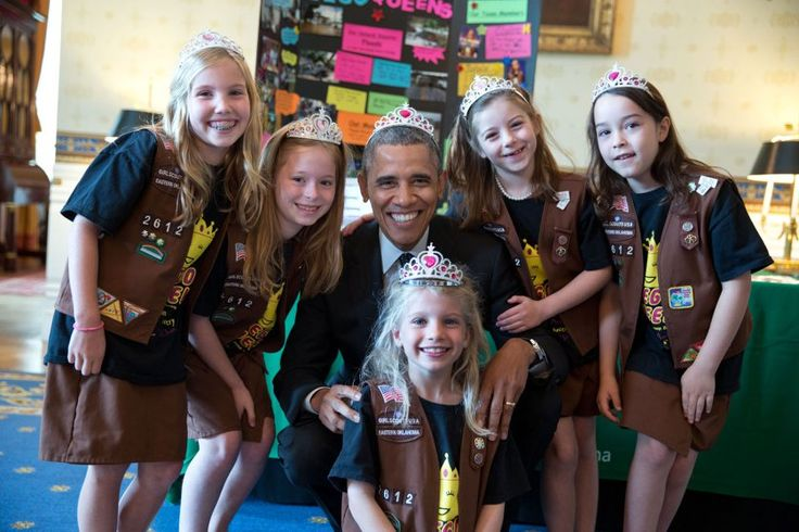 """This photograph was from the annual White House Science Fair. It shows the President posing with Girl Scout Troop 2612 from Tulsa, Oklahoma. I think the 8-year-old girls — Avery Dodson, Natalie Hurley, Miriam Schaffer, Claibyre Winton and Lucy Claire Sharp — are called 'Brownies.' They had just shown the President their exhibit: a Lego flood-proof bridge project. The fair celebrated the student winners of a broad range of science, technology, engineering, and math (STEM) competitions from…"