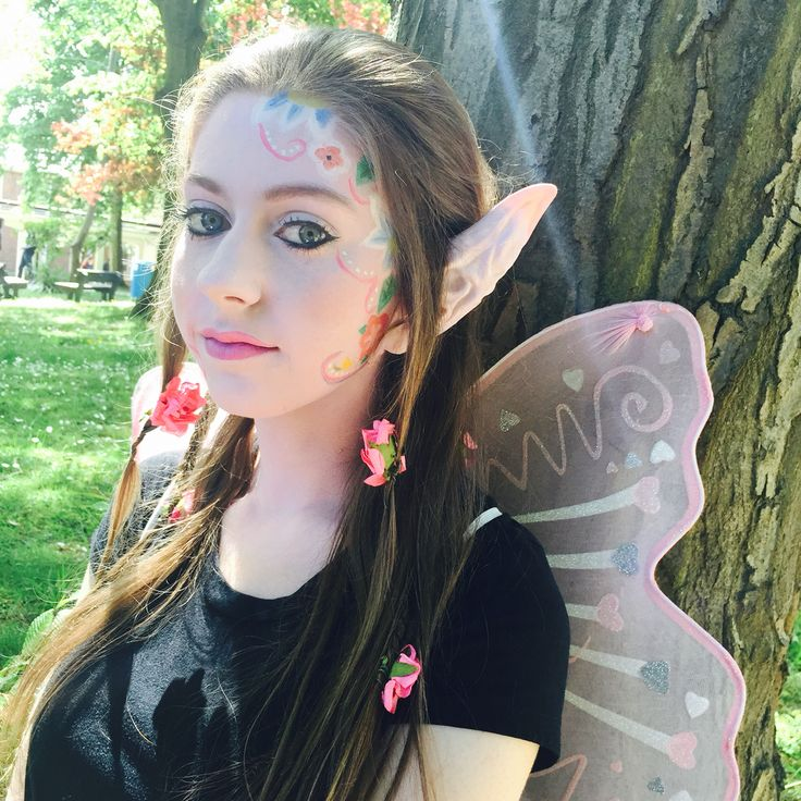 Fantasy flowery pixie with prosthetic ears