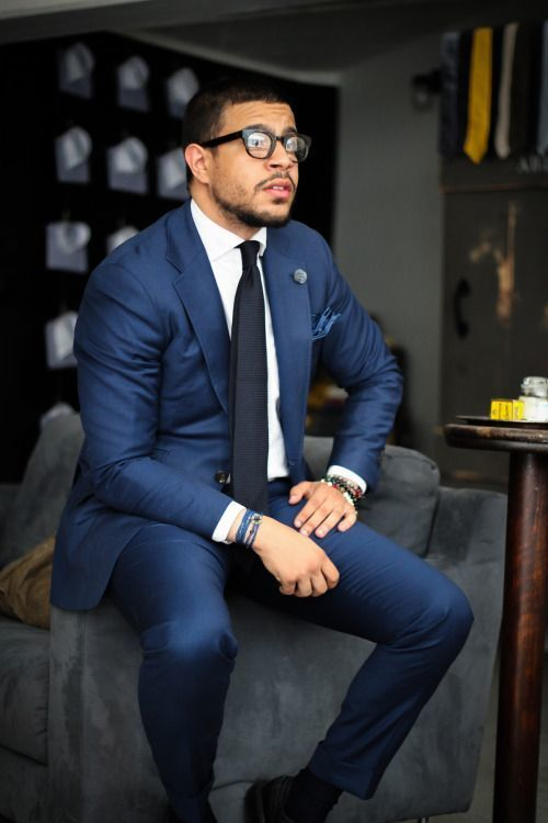 Choose a navy suit and a white oxford shirt to ooze class and sophistication.   Shop this look on Lookastic: https://lookastic.com/men/looks/navy-suit-white-dress-shirt-black-tie/16133   — White Dress Shirt  — Navy Pocket Square  — Black Tie  — Navy Suit