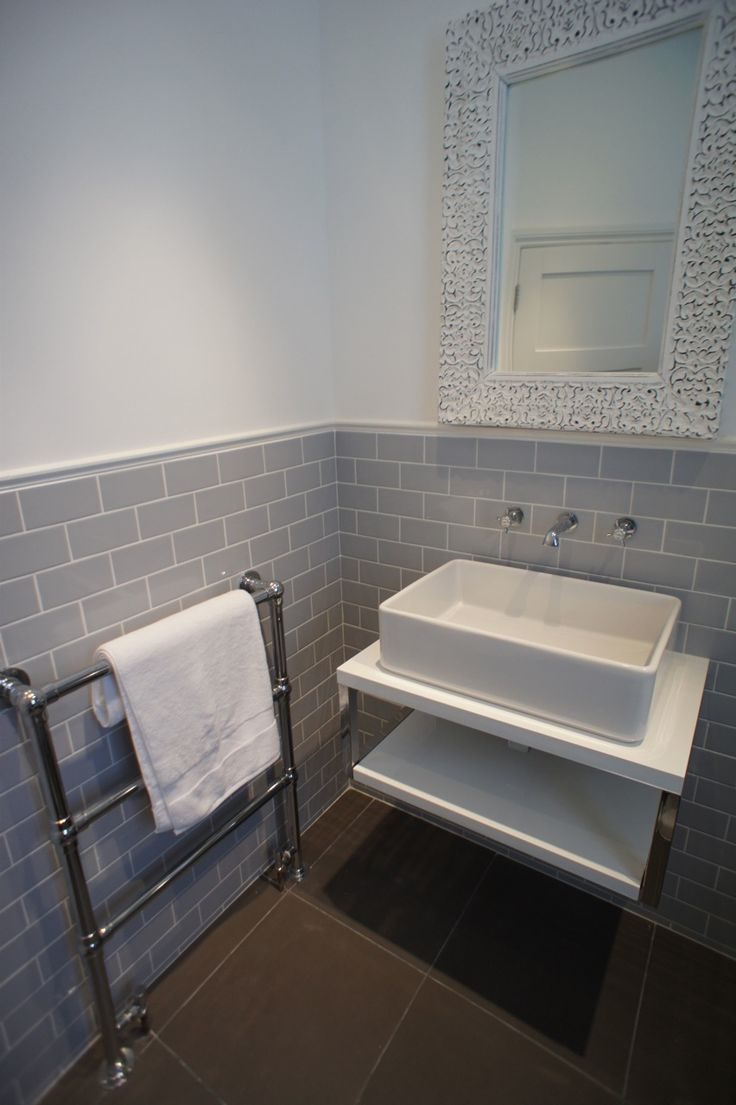 i like the tile these photos were sent in from an interior designer who created this beautiful bathroom using our grey flat retro metro