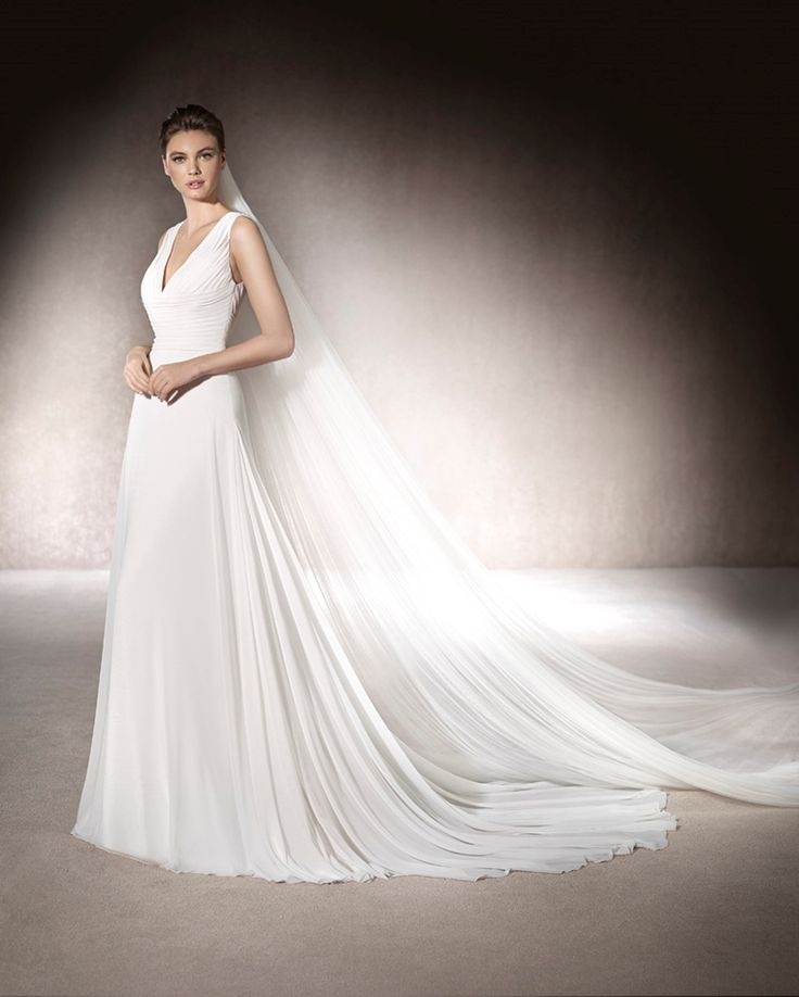 MOLDAVIA - Romantic flared wedding dress in gauze. Elegant, draped V-neckline and lace back, with thread embroidery creating a gorgeous floral decoration