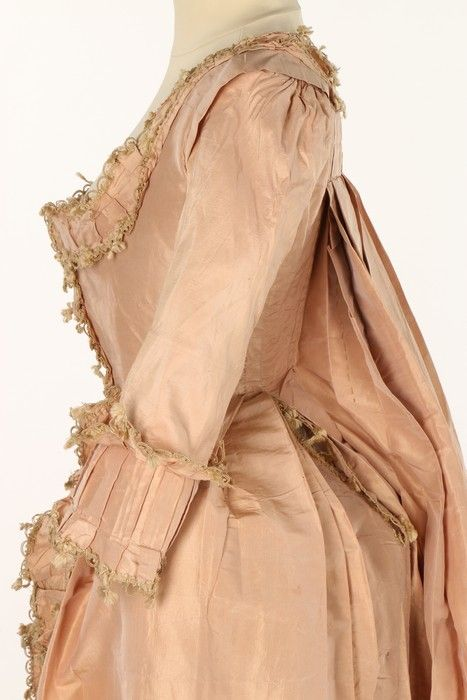 Robe à la francaise, 1770s. Old-rose silk, cuffs ande dges trimmed with pleated bands of matching silk edged in beige fly braid.