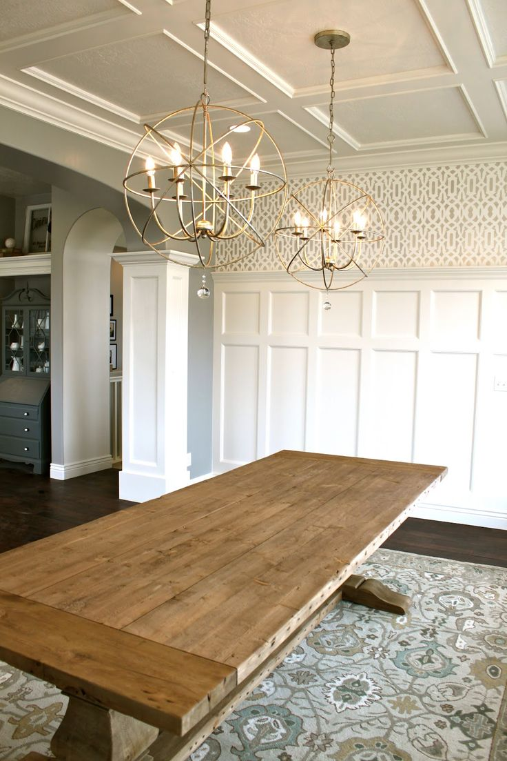 Farm table, lighting, judges panelling, wallpaper, and flat back ceiling.  All
