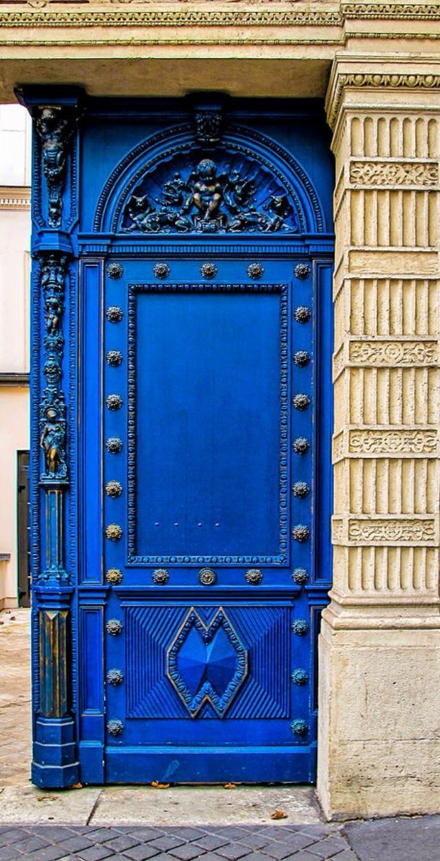 Paris, France Magnificent blue entry front door with detail