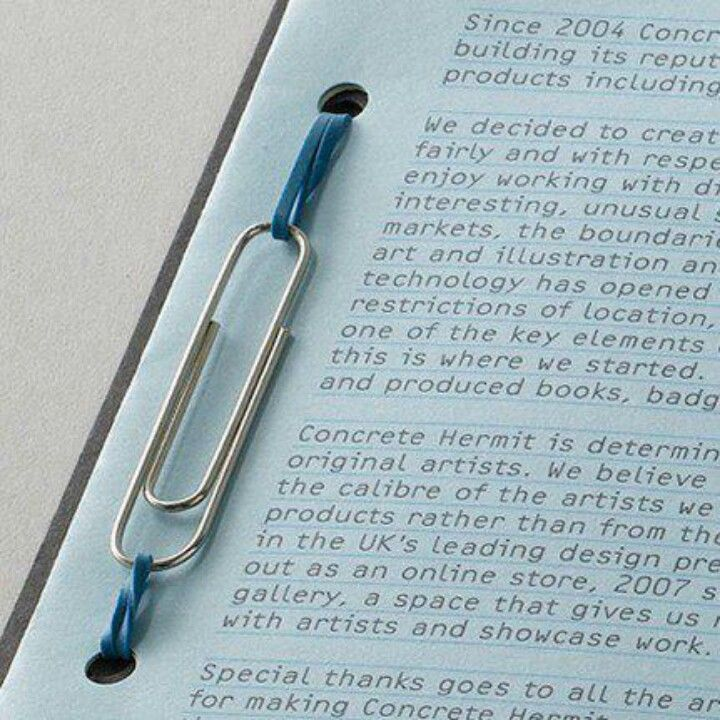 Clever use of paper clip and elastic band to bind book