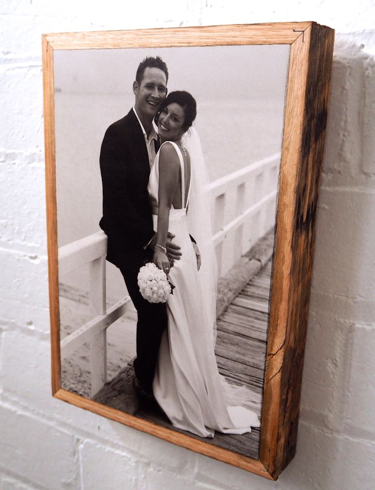 Wedding present from the groom to the bride.. Print on stone, framed by recycled hardwood.