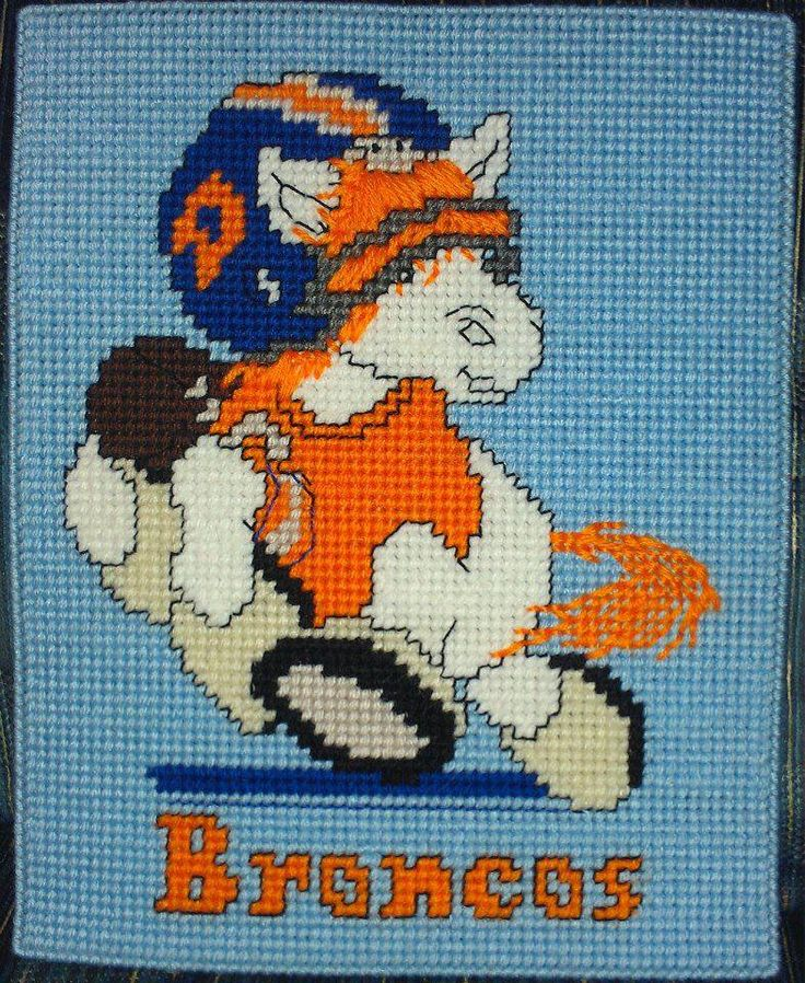 My grandson is a Broncos fan. I used a cross stitch pattern on plastic canvas and framed this for him for his birthday.
