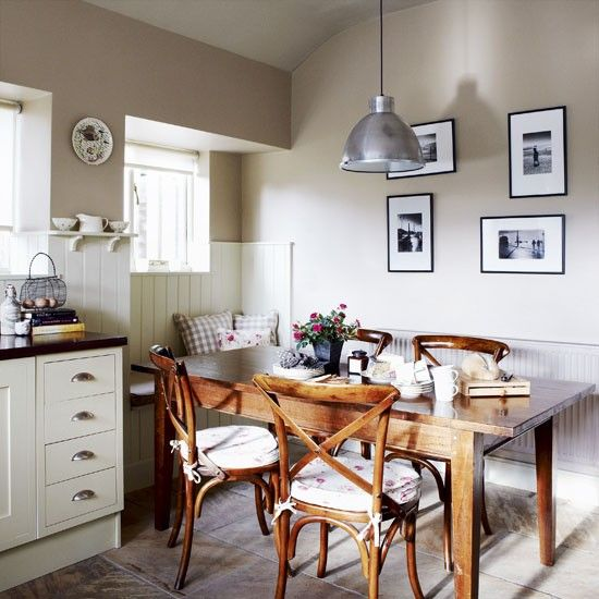 Country kitchen - diner ~ Simple Shaker painted units, tongue-and-groove cladding, a window seat and a stone floor combine to create a classic country kitchen-diner.