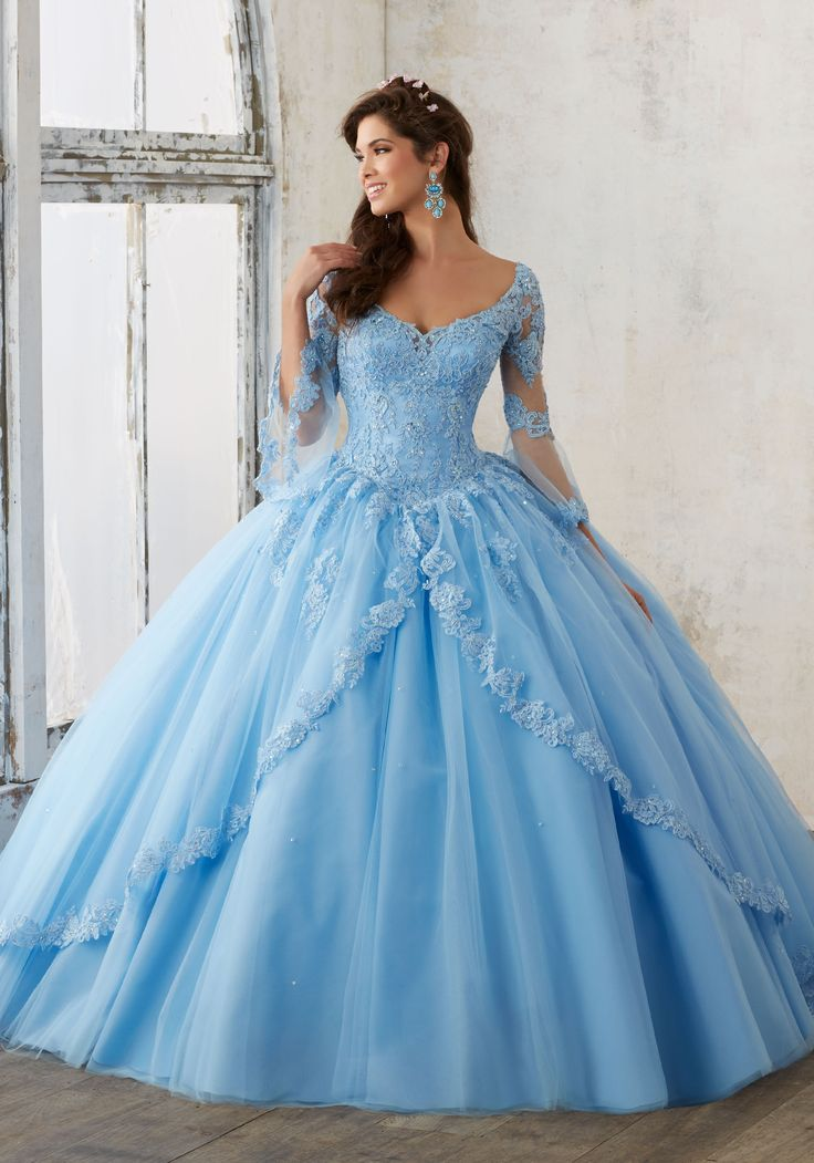 Beaded Lace on a Princess Tulle Quinceañera Ball Gown   Valencia Style 60015   Quinceanera Dresses by Morilee designed by Madeline Gardner. Feminine Bell Sleeves and Lace Details Create the Perfect Princess Look.