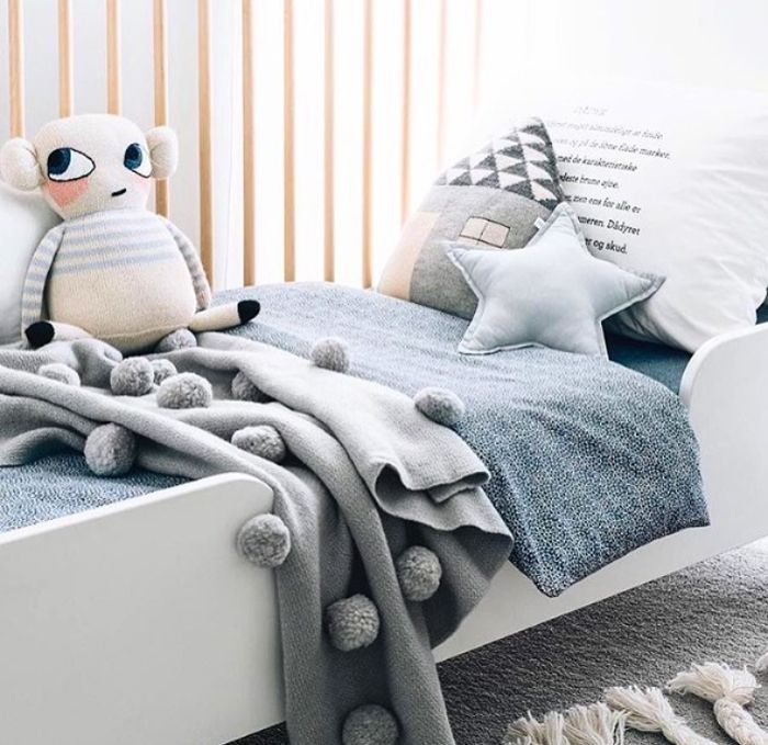 This beautiful merino wool pom pom blanket is super soft and snuggly warm, just right for babies, toddlers and kids http://petitandsmall.com/blanket-kids-room/