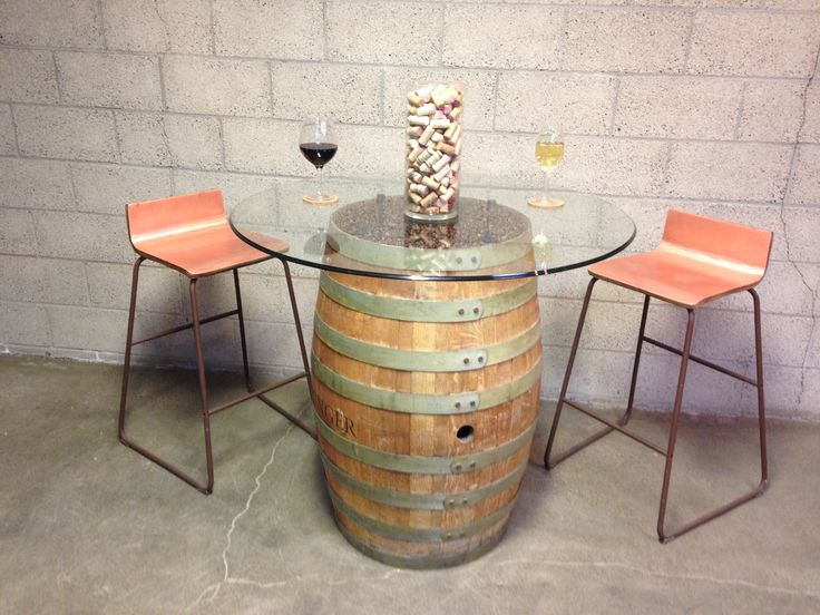 Kask- Authentic wine barrel converted into a bistro style table,glass top mounted on standoffs w/ coffee beans displayed under it in showcase fashion.#wine#winery#culinary#furniture#bistro#tastingroom#restaurant#napa#sonoma#pasorobles#tables#seating#unique#functional#celllar