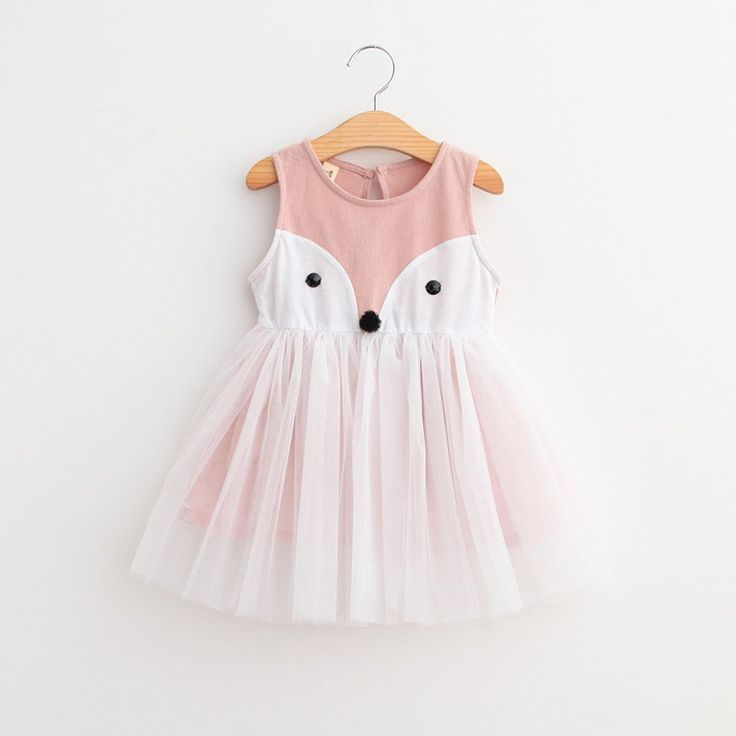 Precious fox dress with tulle skirting overlay. Comfortable and fun to wear.