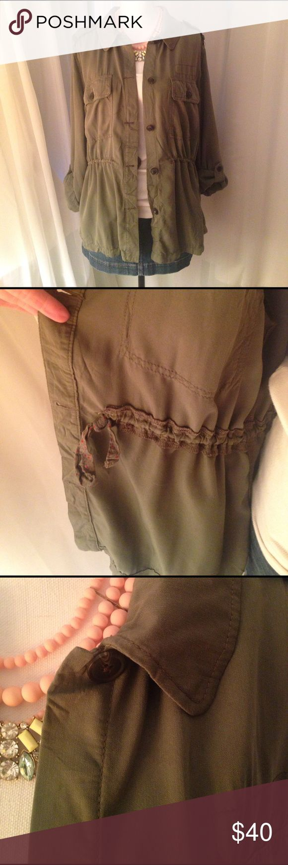 Military jacket Beautiful and lightweight! Olive green military jacket cinches at the waist to make it adjustable. Sleeves roll with epilets. 2 front pockets. Button down. Rayon/Poly blend. American Eagle Outfitters Jackets & Coats
