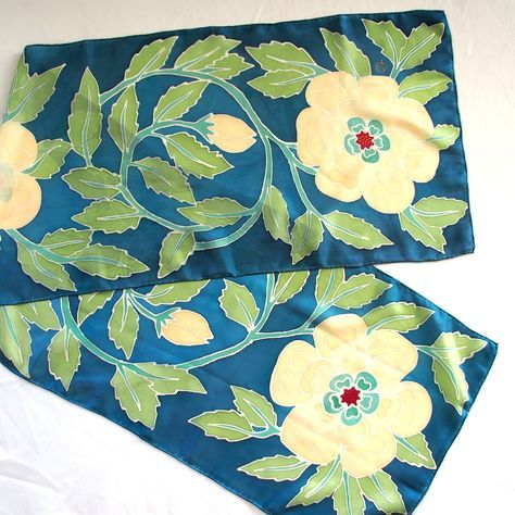 "Tudor Rose Art Nouveau inspired Silk Scarf is hand-painted in serti (cold batik) techniques. The scarf will make great gift for art lover. Light-weight, smooth and bright. 100% Habotai Silk. Size 15"" x 60"". Colors are fixed and permanent, hems are hand stitched. Hand-painted in USA in smoke and pet free environment. My hand painted scarves are truly one of a kind and not mass products since I don't use templates.The designs might be similar but never the same, so If you find..."