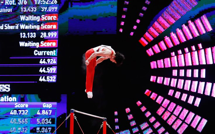 Kohei Uchimura of Japan performs on the Horizontal Bar at the 46th FIG Artistic Gymnastics World Championships in Glasgow, Britain