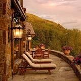 Outside this luxurious lodge, breathtaking views of rolling mountains in Aspen.