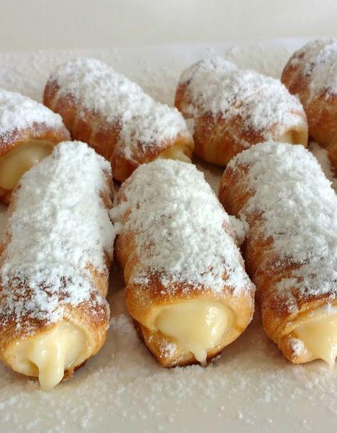 Canutillos de hojaldre rellenos de crema pastelera