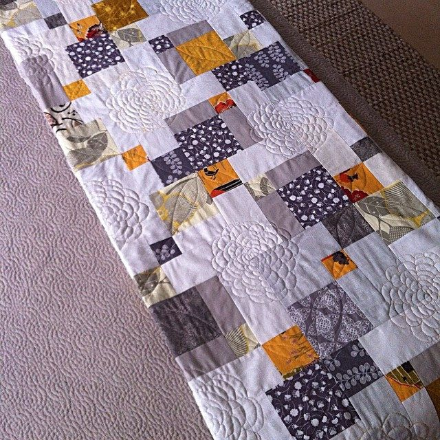 Double disappearing nine patch with beautiful quilting! This is soooooo cool. Great tutorial. xxx