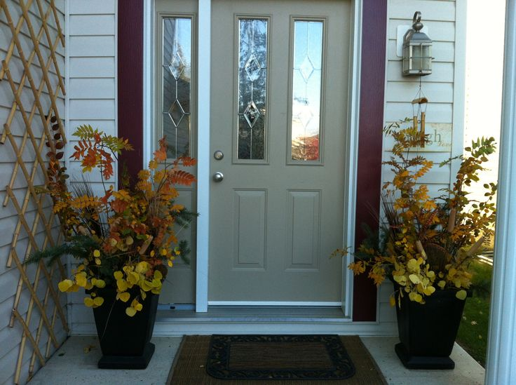 Front door urns with fall foliage.