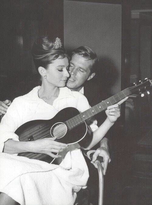 Audrey Hepburn and George Peppard on the set of Breakfast at Tiffany's, 1961.