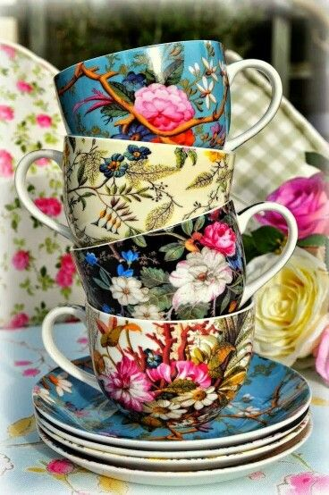 Antique floral chintz prints...I really like the idea of mixing different prints in multi-colors ...