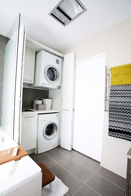 small laundry space - merge downstairs bathroom with laundry behind cupboards (incorporate hot water system into cupboard too)