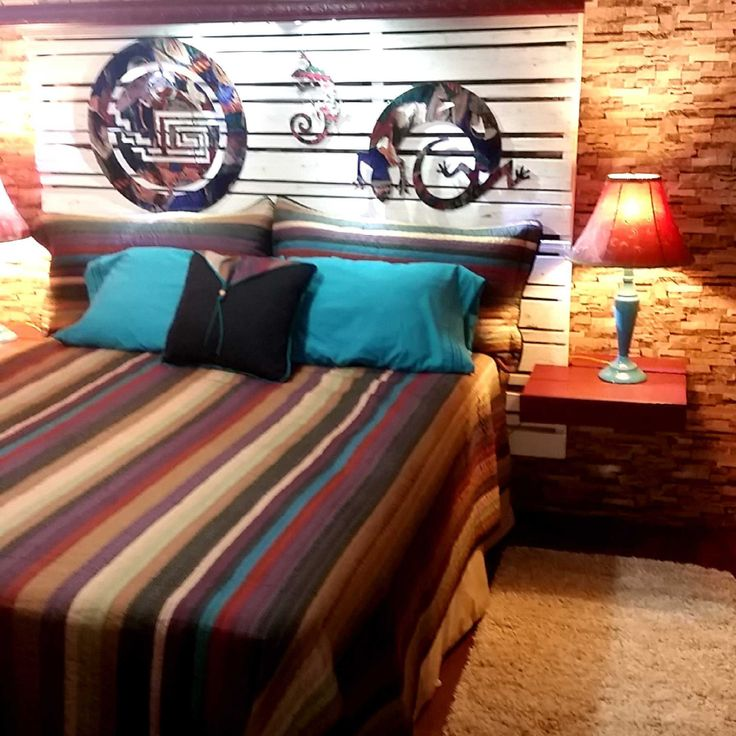 #Bedroom, #PalletBed, #PalletHeadboard, #RepurposedPallet I decided to add a southwestern theme to my bedroom using a large pallet my son brought home from work. The pallet measures 60 x 75 inches and makes an impressive queen size headboard as is. The only modifications I made were adding furring strips