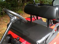 You can recover your vinyl seats with a new set of vinyl seat covers - you don't need to take off the old vinyl.  Simply put the new covers over the old ones to make your golf cart look like new.