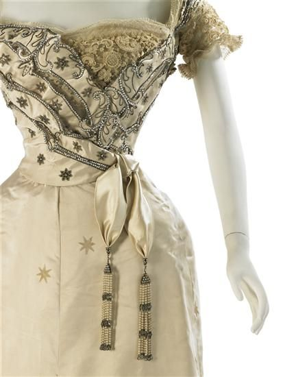 Details from antique cream & gold evening dress with intricate beading & star accents from House of Worth (1905).