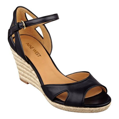 "Espadrille wedge sandal with color block piping detail. Peep toe sandal. Wedge 3"" and platform 1/4"". Adjustable buckle closure. Leather upper."