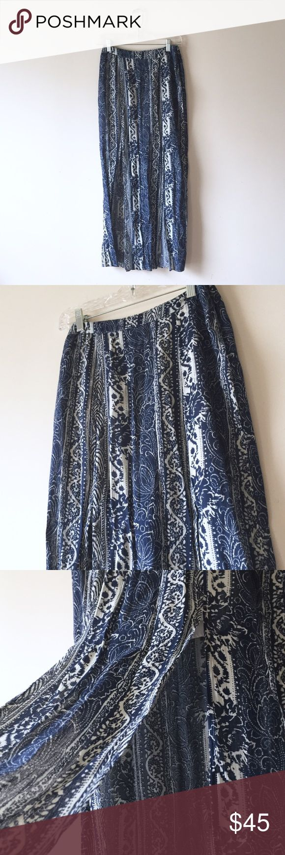 ❄️American Eagle tribal double slit maxi skirt Size 4. Blue and white tribal print. Two frontal slits, light and airy skirt. Worn once, like new. American Eagle Outfitters Skirts Maxi