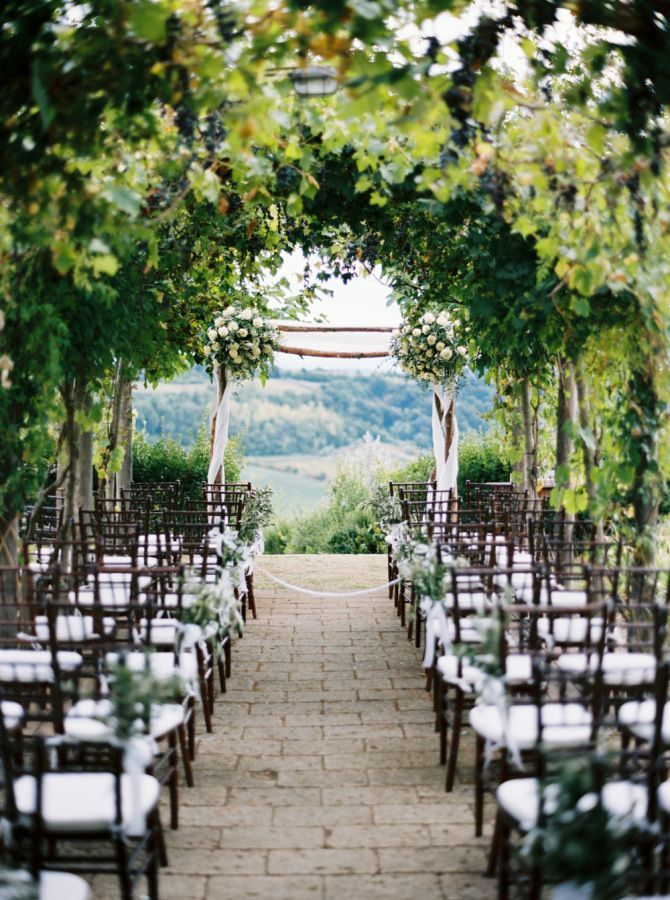 Dreamy outdoor wedding ceremony in Tuscany: http://www.stylemepretty.com/2015/11/18/classic-tuscan-villa-wedding/ | Photography: Katie Grant - http://www.katiegrantphoto.com/