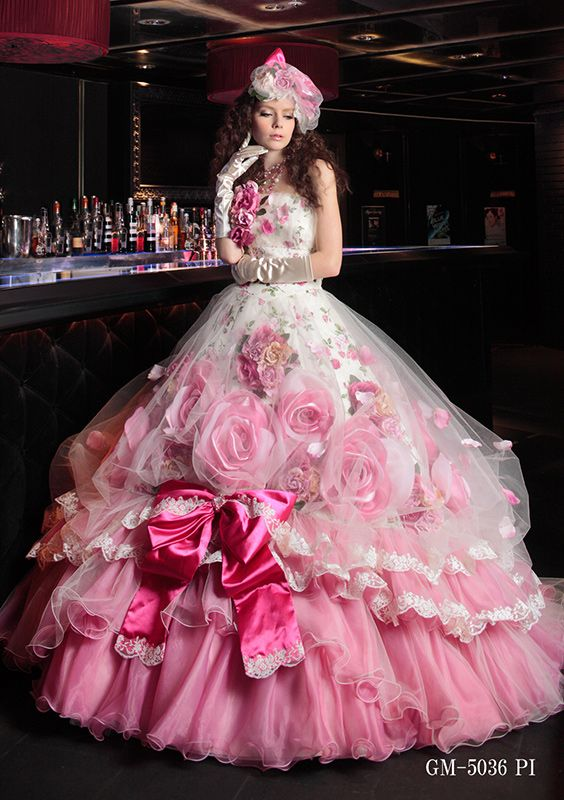 [Whatever possessed them to stick that fuchsia bow on there?  The color is wrong, the style is wrong, the size is wrong.  Otherwise, this is a highly creative gown (admittedly, somewhat over-the-top, but hey--why not?).   But the bow has to go.]   I don't care, I like it.