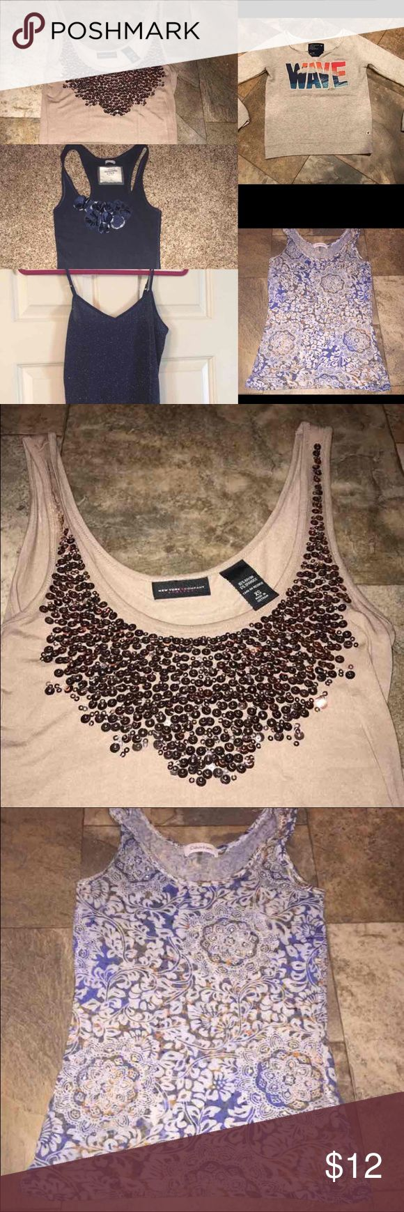 "5 tank tops Abercrombie and fitch Calvin Klein xs 5 tank tops bundle deal all xsmall Express new with tags sparkle navy cami tank top  Calvin Klein embellished floral like design tank top Abercrombie and fitch navy tank top American eagle ""wave"" sweatshirt New York and company sequined tank top   Let's bundle !  10% off on ANY two items purchased AND shipped together.  15% off ANY three items purchased AND shipped together! Tops Tank Tops"