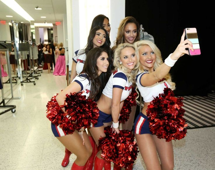 The Houston Texans cheerleaders take a selfie during a runway show supporting Dec My Room at Tootsies. Photo: Jon Shapley, Houston Chronicle / © 2015  Houston Chronicle