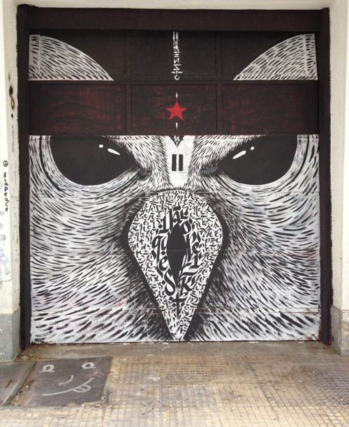 Amazing owl graffiti on a garage door in Athens Greece by Greek street artists DonForty and Blaqk.