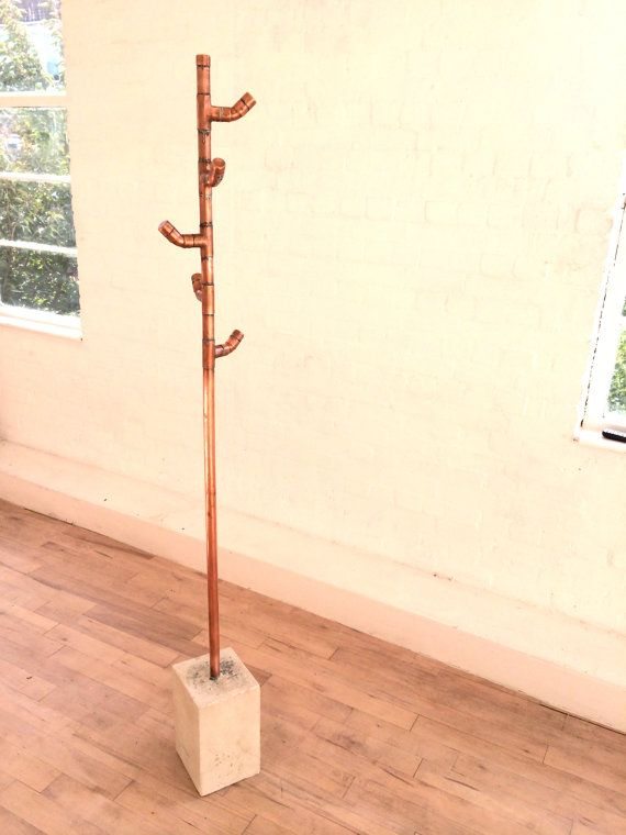 Freestanding coat stand constructed from soldered copper pipe and copper fittings, set in snowcrete. Height: 190cm Footprint: 20x20cm  I design and hand build bespoke furniture from copper, steel, concrete and reclaimed timber in a lively cooperative workshop in East London. Get in touch for commissions or if you have specific dimension requirements.  All pieces are made to order, so please allow up to 4 weeks lead time.  I can arrange delivery by courier to most of the country for the…