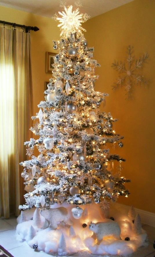 Love the Arctic Scene beneath the tree:: and most especially the beautiful,lighted Snowflake Topper.. .