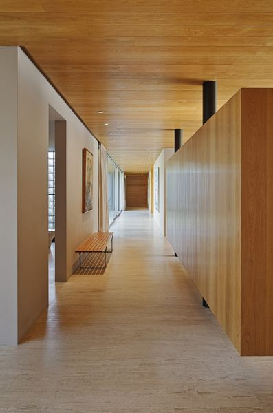 wood partition walls that seem to hover, and are detached from the columns... idea for offices? perhaps with sky lights within the individual rooms to make them glow