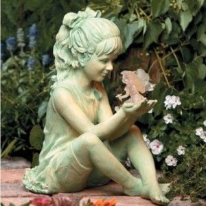 Child Garden Statue Holding Fairy
