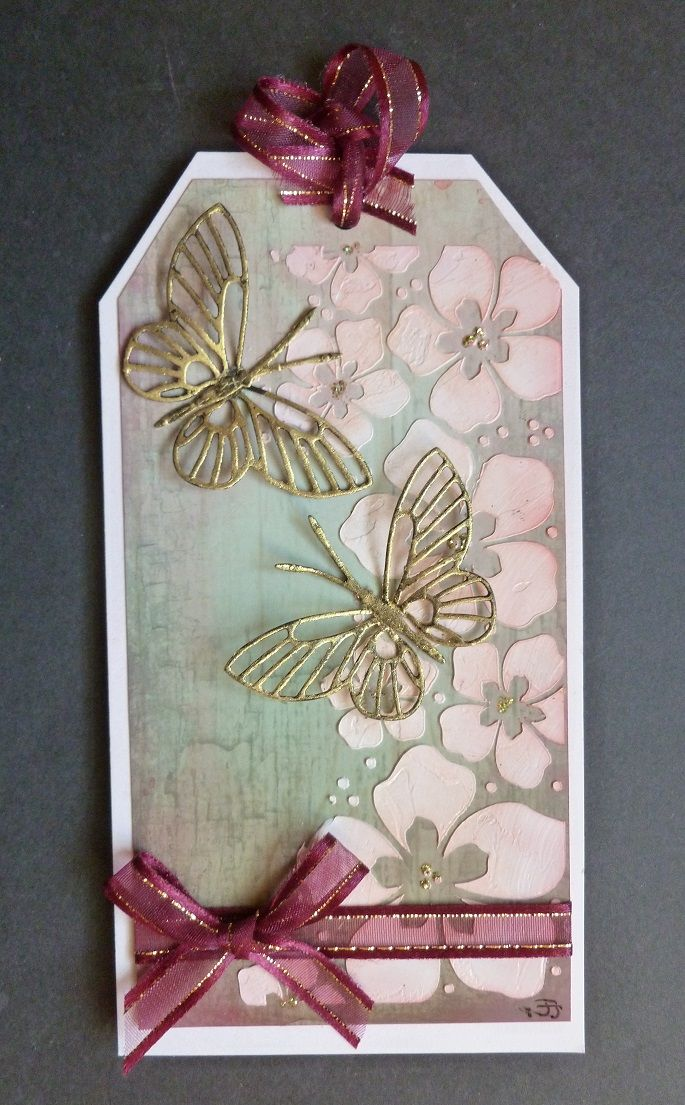 'Butterfly Blossoms' Tag. - Imagination Craft's - Summer blossom border stencil.  White stencil medium.  Metal spatula.  Panel background card - 'Shutters, pepper.'  White gold Starlight wax.  Magi-bond glue.  Sage green Sparkle Medium.  Memory Box butterfly die.  February 2017.   Designed by Jennifer Johnston.