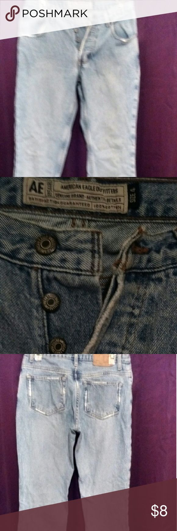 AE button fly jeans Button fly light wash jeans with floral print on back bottom ankles, the bottoms are split. American Eagle Outfitters Jeans Flare & Wide Leg