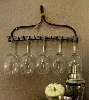 an old iron rake turned wine glass holder