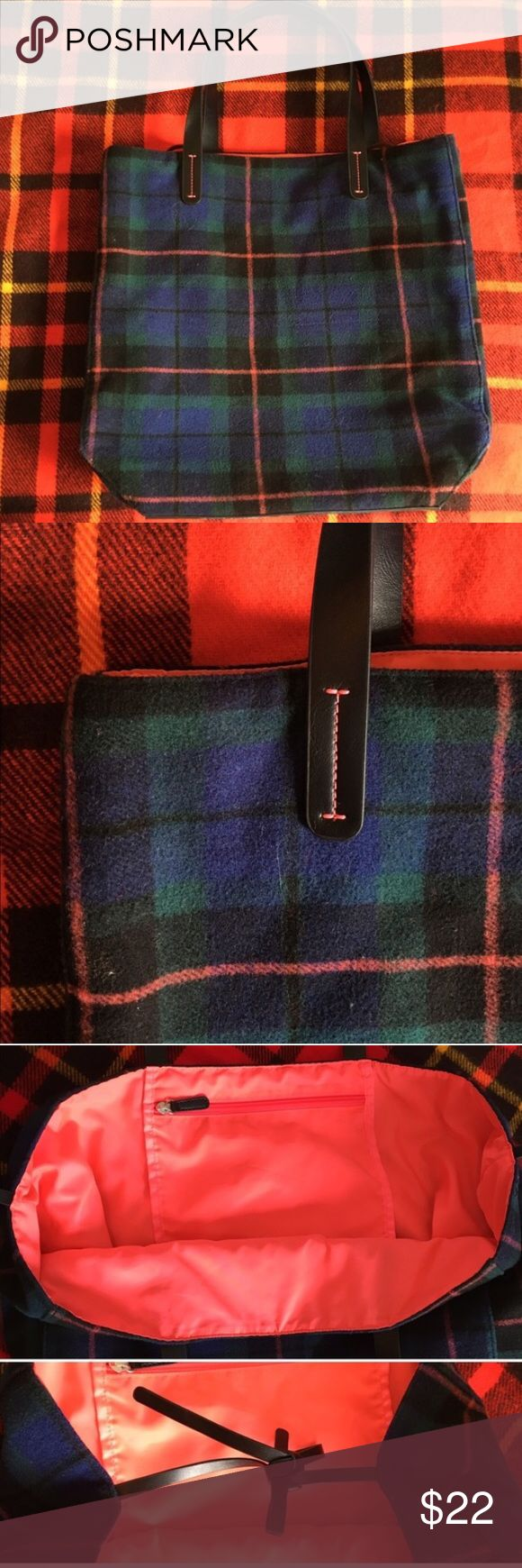 "GAP plaid tote, pink lining, leather handles EUC This colorful and functional GAP tote is perfect as a commuter tote, school bag, or travel! Classic wool plaid exterior with black leather handles and contrast pink stitching. Bright pink lining with interior zip pocket. Leather ties across open top secure contents. Measures 15x15x7"". Handles 1"" thick, 7"" drop 💗 THANK YOU for viewing my closet! Please feel free to make an offer. GAP Bags Totes"