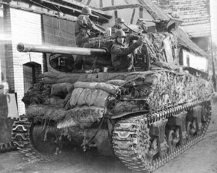 Creative masking Sherman, apparently, is combined with anti shaped-charge protection.