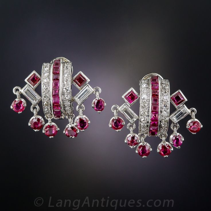 Art Deco Ruby and Diamond Earrings. These fun and fabulous original Art Deco earrings, crafted in platinum, circa 1930, are composed of classic three-row, ruby and diamond hoops embellished on the sides with pairs of angled baguette diamonds and square rubies. Below, 6 bright red, round Burmese rubies dangle and dance with your every move. 1 inch by 3/4 inch.